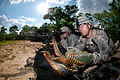 Defense.gov News Photo 110504-A-3108M-003 - Army Spc. Robert Woodworth feeds ammunition to Spc. John Thrasher s M240-B machine gun while providing covering fire in an assault on an enemy.jpg
