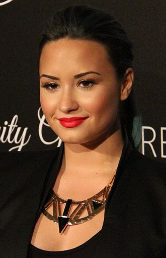 Demi Lovato - Lovato at the Redlight Traffic's Inaugural Dignity Gala in October 2013.