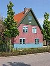 foto van Flevo, vrijstaande houten prefab woning