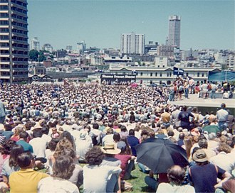 Eureka Flag - ALP policy launch before a huge crowd in the Sydney Domain on 24 November 1975. Eureka Flags can be seen in the crowd and on tribune