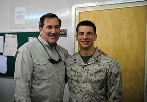 Joe Donnelly - Senator Donnelly with service member of the United States Marine Corps.