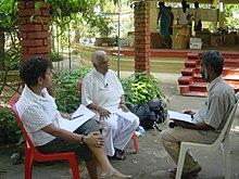 Dr Ariyaratne in discussion.jpg
