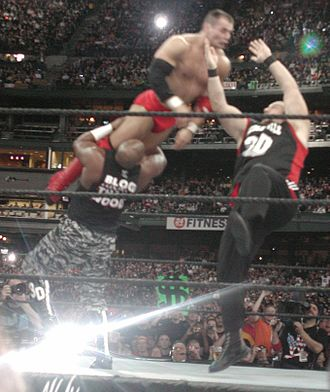 The Dudley Boyz - D-Von (left) and Bubba Ray (right) performing the Dudley Death Drop on Lance Storm.
