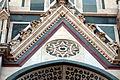 Duomo di firenze, medaglioni intarsiati in marmi nei timpani delle finestre sui fianchi 05.JPG
