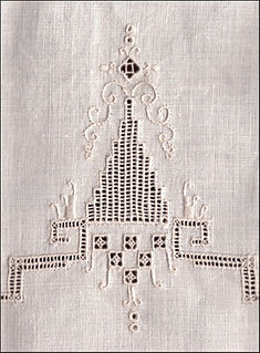 creative textile work decorated by drawing threads out of ground fabric and working stitches over the resulting mesh