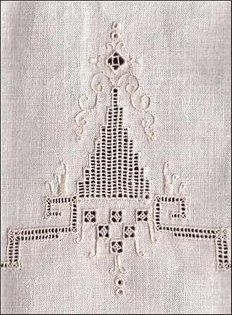 Whitework embroidery - Linen towel with drawn threadwork accented with embroidery in stem and satin stitch.