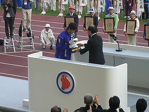 National Sports Festival of Japan - Okayama Prefecture receiving the Emperor's Cup at the closing ceremony of the 60th National Sports Festival