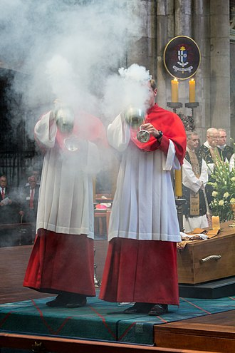 Thurible - Two clergy swing thuribles towards the congregation during the funeral of Joachim Meisner, Cologne Cathedral, 2017.