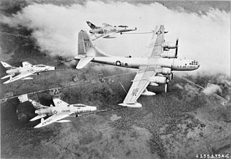 North American F-100 Super Sabre - A USAF KB-50D of the Air Proving Ground Command at Eglin AFB Florida, carrying out the first triple-point refuelling operation with three F-100Cs in 1956