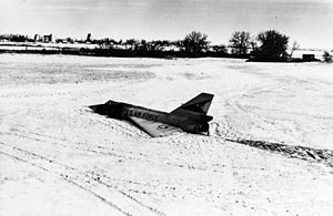 "Cornfield Bomber - The ""Cornfield Bomber"" in its resting place, a frozen Montana field."