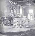 FMIB 34839 Interior of Oyster Cannery, Showing Packing Table, Capping Machine, and Basked In Which the Filled Cans Are 'Processed'.jpeg