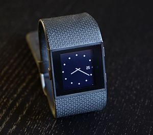 Activity tracker - The Fitbit Surge, showing a clock display as an added feature.