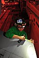 Flickr - Official U.S. Navy Imagery - USS John C. Stennis Sailor removes the leading edge tape off an F-A-18F Hornet wing.jpg