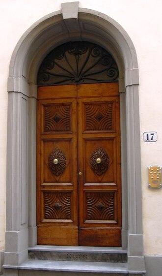 Door furniture - Decorative door in Florence, Italy.