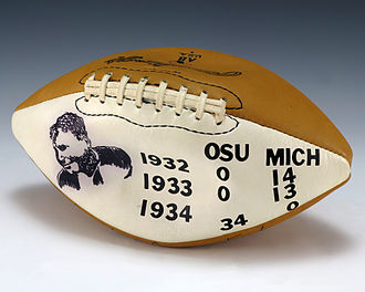 Michigan–Ohio State football rivalry - A football signed by Woody Hayes and gifted to Gerald Ford that lists the scores of the Michigan–Ohio State game from 1932–34, the three years that Ford played on Michigan's varsity team.