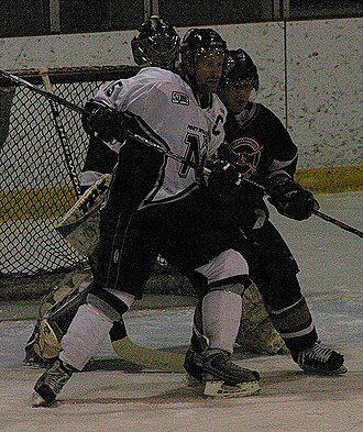 Superior International Junior Hockey League - North Stars Sean Bassingthwaite battles with Fort Frances player (2008)