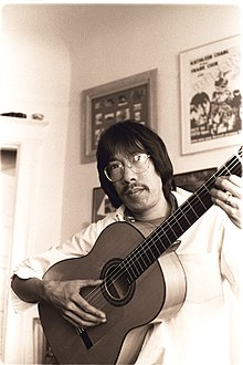 Frank Chin plays the guitar in his San Francisco apartment in 19.jpg