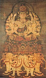 Deity with many arms seated on a pedestal on top of four white elephants.