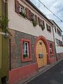 Gebäudekomplex, Verkaufsfenster und Torbogen - IMG 6758.jpg