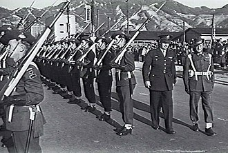 British Commonwealth Occupation Force - General Robert L. Eichelberger inspects the Australian Guard of Honour at Kure.