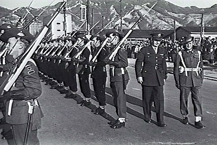 Australian Guard of Honour, at the British Commonwealth Occupation Force headquarters, 1946. General Eichelberger inspects the Australian Guard of Honor at Kure, British Commonwealth Occupation Force Headquarters.jpg