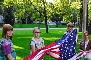 Girl Scouts of the USA - Girl Scouts raising the flag at a Municipal Band concert in Eau Claire, Wisconsin