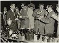 Godfried Bomans en Harry Mulisch jureren een koffiezetwedstrijd op de Grote Markt, georganiseerd door de koffieclub. NL-HlmNHA 54005163.JPG