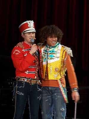 Lucas Grabeel - Grabeel (left) and Corbin Bleu (right) in the High School Musical: The Concert, in 2007.