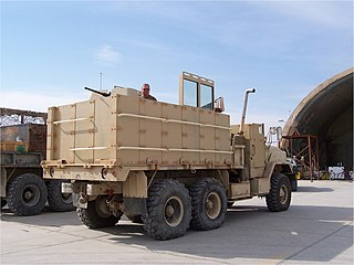Gun truck an armored vehicle with a crew-served weapon