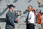 Gunner's Mate 2nd Class Garrett Nelson speaks with President Barack Obama during his visit to USS Ross (DDG 71) (27944507340).jpg