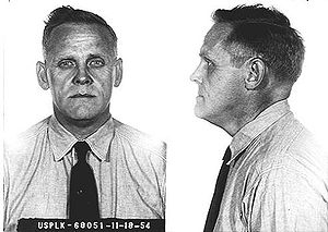 "Gus Hall - Hall's mugshot, taken during his prison sentence in Leavenworth, Kansas for ""Conspiring and Teaching Overthrow of the U.S. Government by Force or Violence"". Date 1954."
