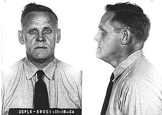 """Gus Hall - Hall's mugshot, taken during his prison sentence in Leavenworth, Kansas for """"Conspiring and Teaching Overthrow of the U.S. Government by Force or Violence"""". Date 1954."""