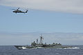 HMAS Darwin with a US Navy helicopter during RIMPAC 2012.jpg