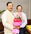 Harsh Vardhan greeting the new Minister of State for Environment, Forest & Climate Change, Dr. Mahesh Sharma, in New Delhi.jpg