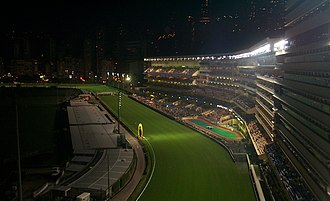 Happy Valley Racecourse in Hong Kong at night Hongkongjockeyclub.jpg