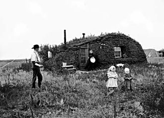 Homestead Acts - Norwegian settlers in 1898 North Dakota in front of their homestead, a sod house