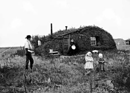 Norwegian settlers in front of their sod house in North Dakota in 1898 Hultstrand61.jpg