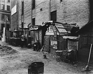 Hooverville - Huts and unemployed in West Houston and Mercer St by Berenice Abbott in Manhattan in 1935