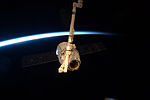 ISS-31 SpaceX Dragon is grappled by Canadarm2.jpg