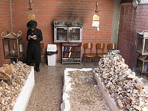 Ohel (grave) - The graves of Grand Rabbi Avraham Mordechai Alter (right) and his son, Grand Rabbi Pinchas Menachem Alter (left) in an ohel adjacent to the Sfas Emes Yeshiva in downtown Jerusalem.