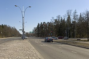 Munkkivuori - The accident site i.e. the intersection of Huopalahdentie (towards the camera) and Ulvilantie (on the right) in 2009. The girls were crossing the road from the right to the left. A stationary car, as in the photograph, was in the right lane. The cars in the photograph are not related to the accident.