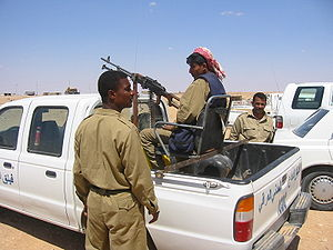 National Guard (Iraq) - Iraqi National Guard troops with a PK machine gun mounted on a Ford Ranger