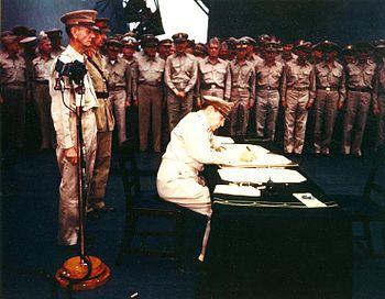 MacArthur signs Japanese surrender instrument ...