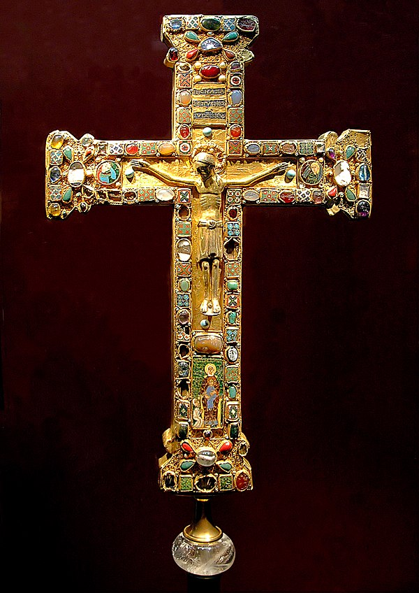 The Cross of Mathilde, a crux gemmata made for Mathilde, Abbess of Essen (973-1011), who is shown kneeling before the Virgin and Child in the enamel plaque. The figure of Christ is slightly later. Probably made in Cologne or Essen, the cross demonstrates several medieval techniques: cast figurative sculpture, filigree, enamelling, gem polishing and setting, and the reuse of Classical cameos and engraved gems. JuengeresMathildenkreuz.jpg