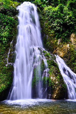 Karbi Anglong district - The scenic beauty of Kanthi waterfall, situated in Kanthi Village, some 12 kilometers away from Dengaon in Karbi Anglong district of Assam in India.