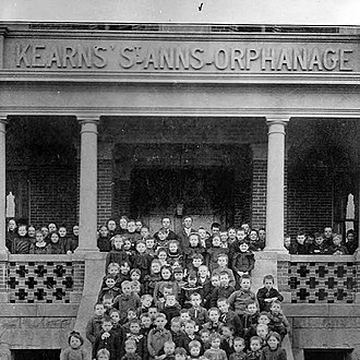 Kearns-Saint Ann Catholic School - A gathering of the orphans on the steps of the Kearns' St. Ann's Orphanage