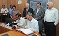 Kapil Sibal and the Chairman, UIDAI, Shri Nandan Nilekani witnessing the signing of an MoU between Ministry of Human Resource Development and Unique Identification Authority of India (UIDAI), in New Delhi on October 27, 2010.jpg