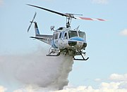 Kern County (California) Fire Department Bell 205 dropping water on fire