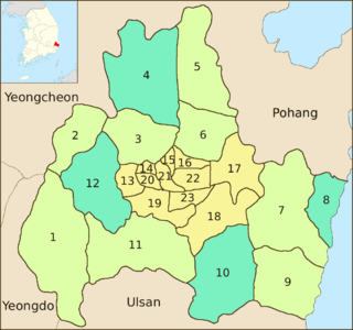 Map of the coastal district previously mentioned. Its center, covering about a sixth of the area, is divided into 11 subdivisions. The surrounding regions are divided into eight subdivisions in a different color. The rest, four subdivisions in a third color, are scattered to the northeast, west, southeast and east respectively.