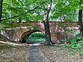 Królikarnia Palace - bridge in the park 02.jpg
